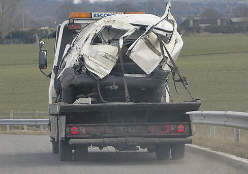 Tthe white Citroen Berlingo in which the three siblings had been travelling is taken away after the crash