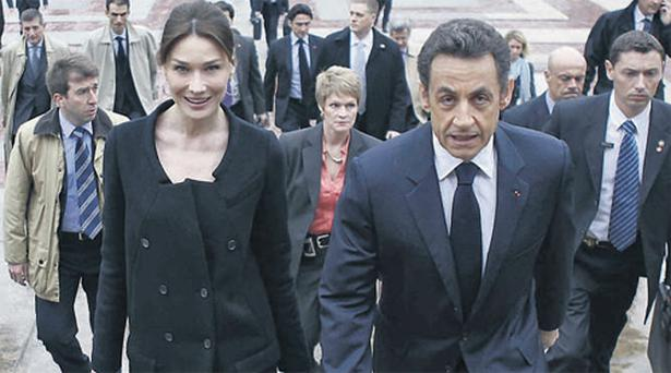 French President Nicolas Sarkozy and his wife, Carla Bruni, arrive at the World Leaders Forum at Columbia University in New York yesterday