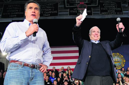Republican presidential candidate and former Massachusetts Governor Mitt Romney is joined by U.S. Senator John McCain (R-AZ) (R) at a campaign stop in Manchester, New Hampshire January 4, 2012, one day after Romney won the Iowa caucus. REUTERS/Brian Snyder (UNITED STATES - Tags: POLITICS ELECTIONS)
