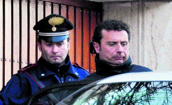 Costa Concordia cruise liner captain Francesco Schettino (R) is escorted by a Carabinieri in Grosseto January 14, 2012. Schettino, the captain of the Italian cruise liner that ran aground off Italy's west coast, was arrested on the charges of multiple manslaughter, causing a shipwreck and abandoning ship, police said on Saturday. Italian rescue workers were searching for nearly 40 people still missing early on Sunday, more than a day after the cruise ship with more than 4,000 on board capsized, killing at least three people and injuring 70. Picture taken January 14. REUTERS/Enzo Russo/ANSA (ITALY - Tags: DISASTER TRANSPORT TPX IMAGES OF THE DAY) FOR EDITORIAL USE ONLY. NOT FOR SALE FOR MARKETING OR ADVERTISING CAMPAIGNS. THIS IMAGE HAS BEEN SUPPLIED BY A THIRD PARTY. IT IS DISTRIBUTED, EXACTLY AS RECEIVED BY REUTERS, AS A SERVICE TO CLIENTS. ITALY OUT. NO COMMERCIAL OR EDITORIAL SALES IN ITALY