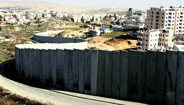 A section of the controversial Israeli barrier is seen between the Shuafat refugee camp (R), in the West Bank near Jerusalem, and Pisgat Zeev (rear), in an area Israel annexed to Jerusalem after capturing it in the 1967 Middle East war, January 27, 2012. Israel has presented Palestinians with its ideas for the borders and security arrangements of a future Palestinian state, in a bid to keep exploratory talks alive, Palestinian and Israeli sources said on Friday. REUTERS/Baz Ratner (JERUSALEM - Tags: POLITICS)