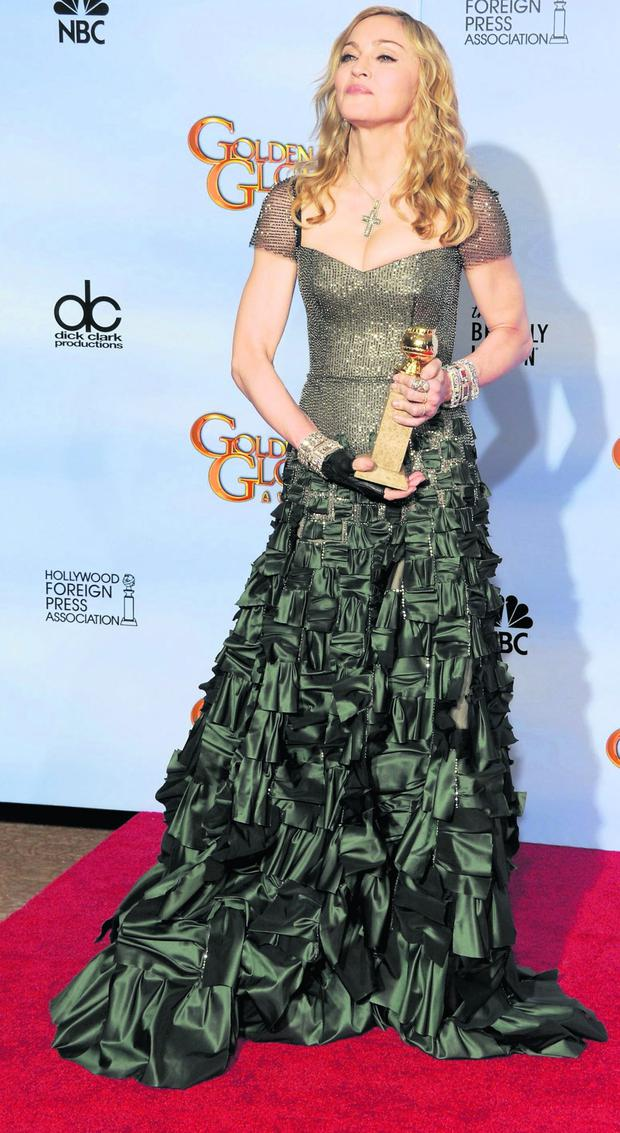 BEVERLY HILLS, CA - JANUARY 15: Singer Madonna poses in the press room with the Best Original Song - Motion Picture for