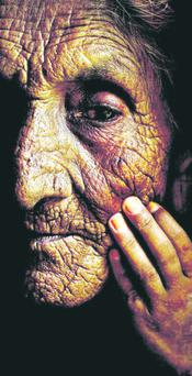 2nd in Portrait LIFELINES MARK CONDREN, IRISH INDEPENDENTA young Pakistani boy touches the face of his 96-year-old grandmother