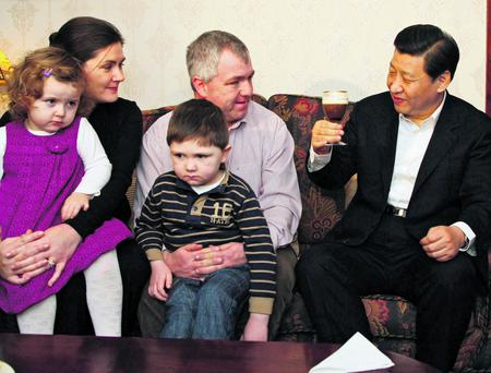 China's Vice President Xi Jinping samples an Irish Coffee while visiting dairy farmers James Lynch and his wife Maura (L), and their children Olive, 3, and James, 5, on the second day of a three day visit to Ireland, at Six Mile Bridge, County Clare February 19, 2012. REUTERS/Maxwell's/POOL (IRELAND - Tags: POLITICS FOOD)