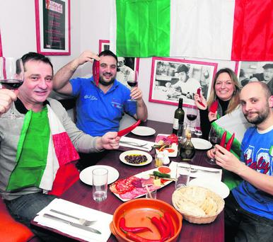 Italian fans Masterchef Luca Mazza, Marco Giannantonio, Isabella Cauarretta and Giuseppe Crupi enjoying a pre match meal together at Pinnochio restuarant in Ranelagh before the rugby match between Ireland and Italy. Picture:Arthur Carron/Collins