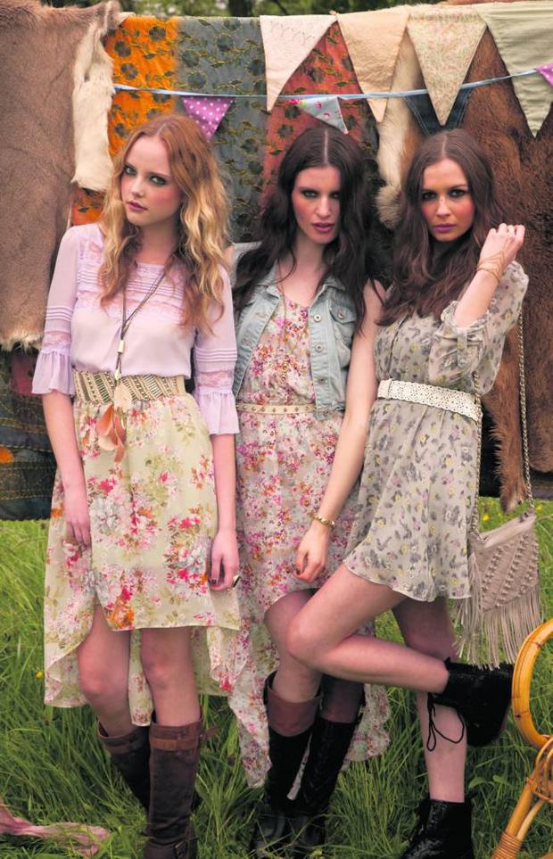 Left to right: Danielle wears feather necklace, €5; purple top, €5; belt, €4; skirt, €13; ring, €3, and suedette boots, €20; Grace wears denim gilet, ¤15; floral asymmetric dress, €19; body chain, €5; studded belt, €3, and black-and-brown boots, €24; Aoife wears grey floral dress, €19; chain ring and bracelet, €5; white belt, €3; fringed bag, €9, and glitter boots, €20