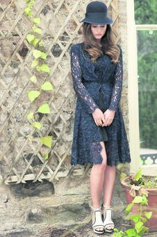 'Libelula' midnight-blue lace coat, €959, and matching dress, €700, both Kalu; bib-front sandals, €290, Reiss, and hat, €85, Shevlin, at Arnotts