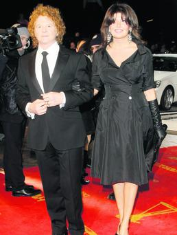 Singer Mick Hucknall and partner Gabriella Wesberry (Photo by Florian Seefried/Getty Images)