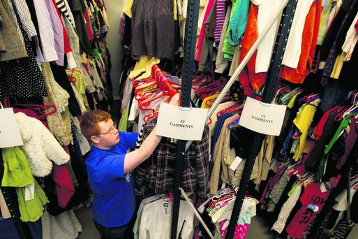 Volunteers sort out donated items at the St Vincent de Paul headquarters in Dublin. Photo: Mark Condren