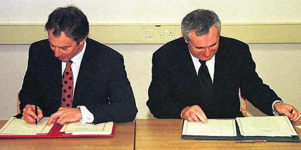 British Prime Minister Tony Blair and Bertie Ahern sign the peace pact that became known as the Good Friday Agreement at Castle Buildings in Stormont, Belfast