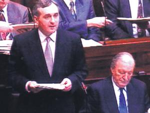 Bertie Ahern, then Finance Minister, in the Dail flanked by Mr Haughey in 1992