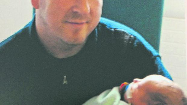 A recent picture of Neilus O'Connor with his baby daughter Hannah. Mr O'Connor was missing after going out on a kayak on the White Sand lake Cromane in the early hours of Friday morning. Photo: Eamonn Keogh (MacMonagle, Killarney)