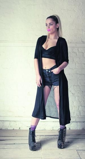 Black sheer-back cardigan, ¤43; vintage shorts, ¤28; and cropped top, model's own