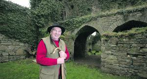 Jerpoint Park Joe O'Connell in the ruins of ST Nicholas church Photo: Ronan Lang/Feature File