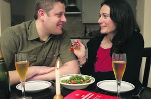 A romantic meal for two... The aphrodisiac encyclopedia.. Katie Gunn serves up a treat for her husband Christian , Pix Ronan Lang/Feature File
