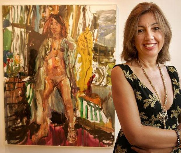 VOLUNTEER: Donnybrook art collector Patricia Tsouros with Nick Miller's nude painting of herself. 'I have no problem with nudity and I love Nick's art, so I really enjoyed it,' she says. Photo: Gerry Mooney