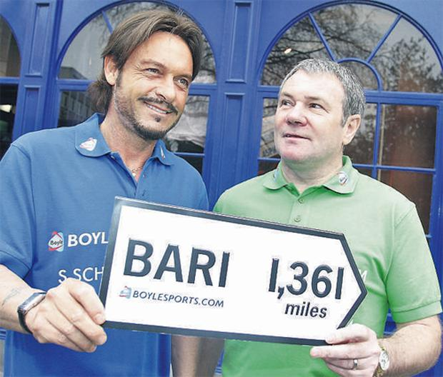 Italia '90 hero Toto Schillaci with former Ireland star Ray Houghton, who scored the winner against Italy at US '94, in Dublin 2009