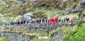 The main bunch on their way to Ladies View during the fourth stage of the Ras from Castleisland to Castletownbere yesterday. Photo: Lorraine O'Sullivan / INPHO