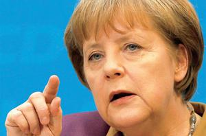 Germany's Chancellor Angela Merkel addressing a news conference in Berlin yesterday