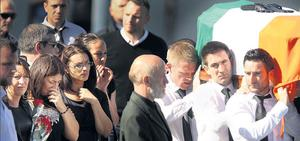 they were carried by his brothers Anthony (middle) and Eoin (front). Photos: Gerry Mooney
