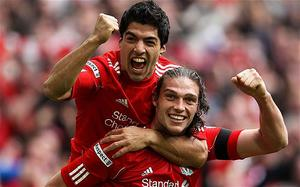 Breakthrough: Andy Carroll celebrates with fellow striker Luis Suarez after scoring the winner for Liverpool in their FA Cup semi-final against Everton. Photo: Getty Images