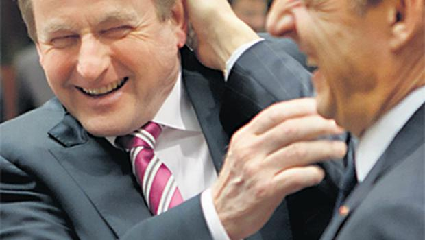 Mr Kenny and French President Nicolas Sarkozy enjoy some horseplay at yesterday's European Council meeting in Brussels