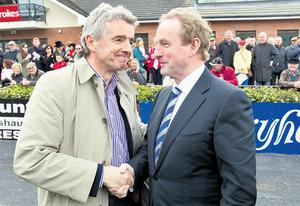 Ryanair boss Michael O'Leary shakes hands with Enda Kenny at Fairyhouse