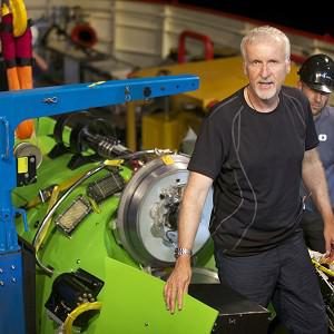 Filmmaker James Cameron emerges from the hatch of a submersible in Jervis Bay, south of Sydney, Australia (AP)