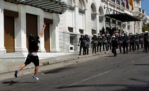 A demonstrator throws a molotov cocktail at riot police. Photo: Reuters