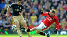 Rooney and Gerrard in action on the pitch