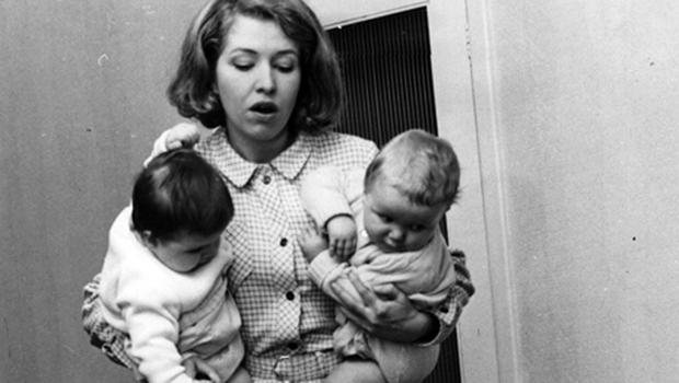 Coronation Street actress Anne Reid seen here doing the hoovering holding her screen twins Susan and Peter under her arms. Photo: Getty Images