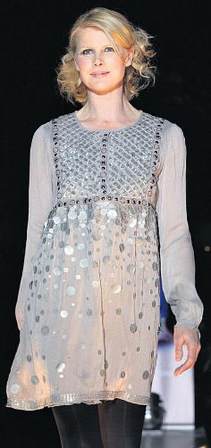 Marie Staunton wears a grey short dress with sequins from Fran & Jane