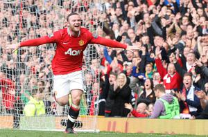 Wayne Rooney celebrates after scoring Manchester United's first goal despite the appeals of West Brom goalkeeper Ben Foster. Photo: Getty Images