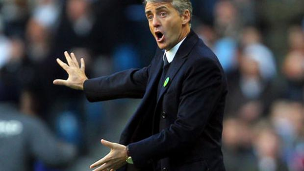 Manchester City boss Roberto Mancini attempts to call the shotsduring his last encounter with Arsenal - which ended 3-0 to Arsene Wenger's men. Photo: Getty Images