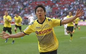 Big in Japan: Shinji Kagawa is posied to complete a transfer from Borrusia Dortmund to Manchester United. Photo: Reuters