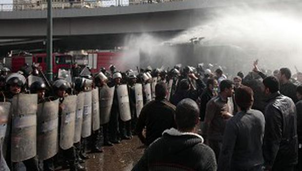 Egyptian police turn water cannon on anti-government protesters in Cairo (AP)