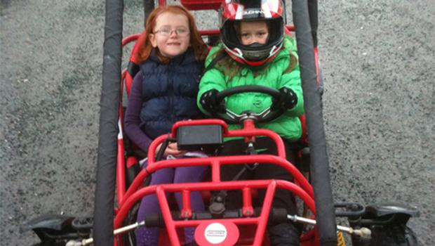 Jessica Peoples and her cousin Dylan playing in the buggy on Christmas Day