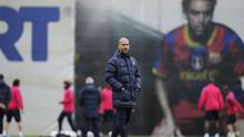 Pep Guardiola takes a moment to himself at Barcelona's training session in Spain yesterday ahead of tonight's Champions  League round of 16 clash with Arsenal. Photo: Getty Images