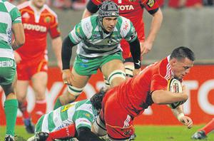 Munster try: James Coughlan, Munster, scores his side's first try despite the efforts of Ludovico Nitoglia, Benetton Treviso, in last Friday's Celtic League match at Thomond Park, Limerick. Photo: Sportsfile