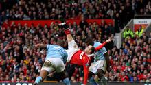 Wayne Rooney of Manchester United scores a goal from an overhead kick. Photo: Getty Images