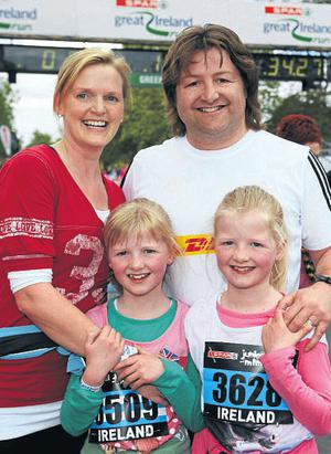 Shane Byrne with wife Caroline and twins Kerry and Alex (9) on completion of the Spar Mini Great Ireland Run.