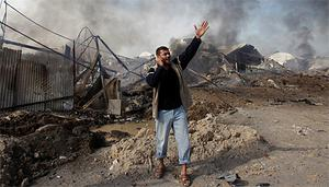 A Palestinian shouts after an Israeli air strike in the southern Gaza Strip
