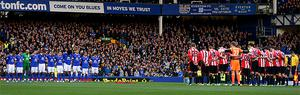 Everton and Sunderland players, including James McClean, observe a minute's silence ahead of the game
