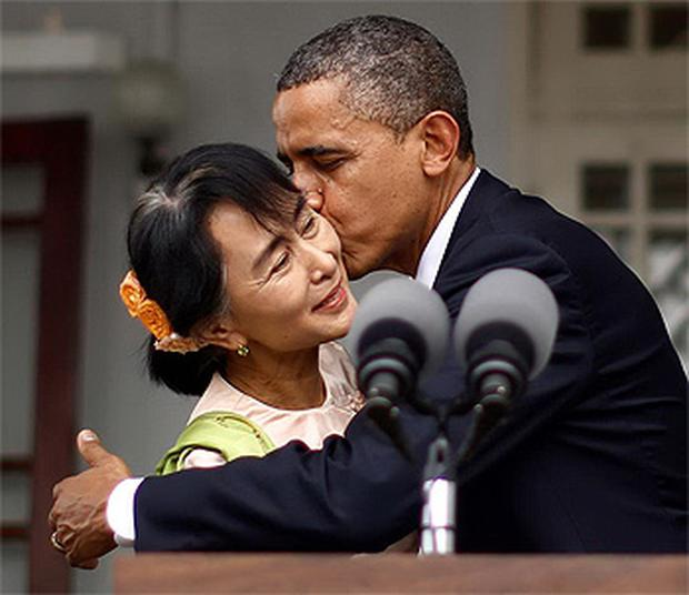 US President Barack Obama kisses Aung San Suu Kyi following a joint address at her residence in Yangon