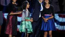 US President Barack Obama waves as he walks on stage with his wife Michelle and daughters Malia and Sasha at his election night party in Chicago. Photo: AP