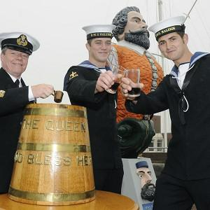 Able Seaman Robert Turner (centre) and Able Seaman Daniel Smith (right) as they receive a tot of rum for their role in the Queen's Diamond Jubilee celebrations (MoD/Crown Copyright)