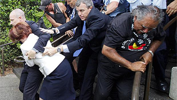 Ms Gillard is rushed out of the Lobby restaurant near Old Parliament House