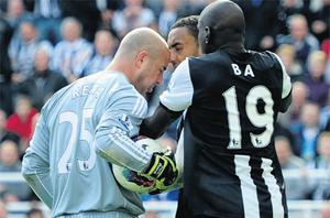 Liverpool's Pepe Reina clashes with Newcastle's James Perch as Demba Ba attempts to intervene