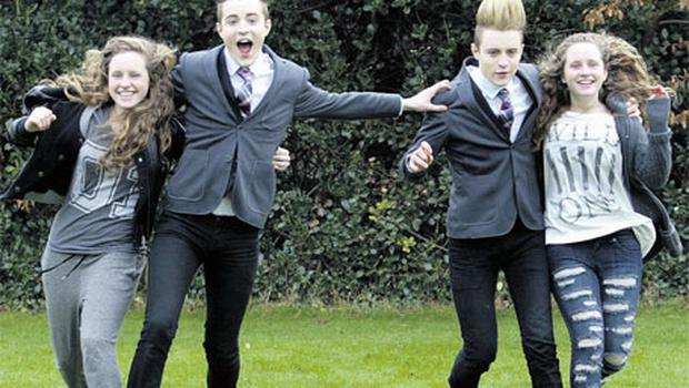 Jedward with twins, Ciara, left, and Niamh Witter (15), launching the Kellogg's Fun Raise 4 Kids Secondary School Challenge in the Iveagh Gardens, Dublin, yesterday