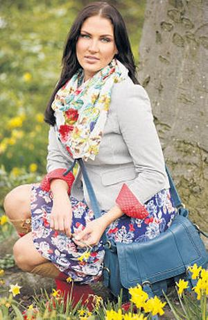 Grey pinstripe cotton jacket, €102; floral cotton shirt, €54; floral-print silk skirt, €90; floral-print scarf, €36; indigo leather satchel, €180, all Dickins & Jones; red wellington boots, €80, Hunter; socks, stylist's own
